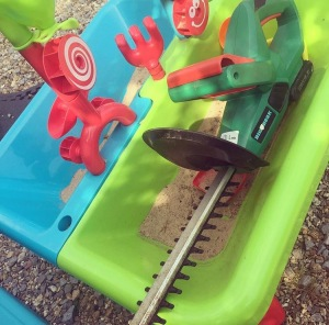 hedge cutter in sandpit